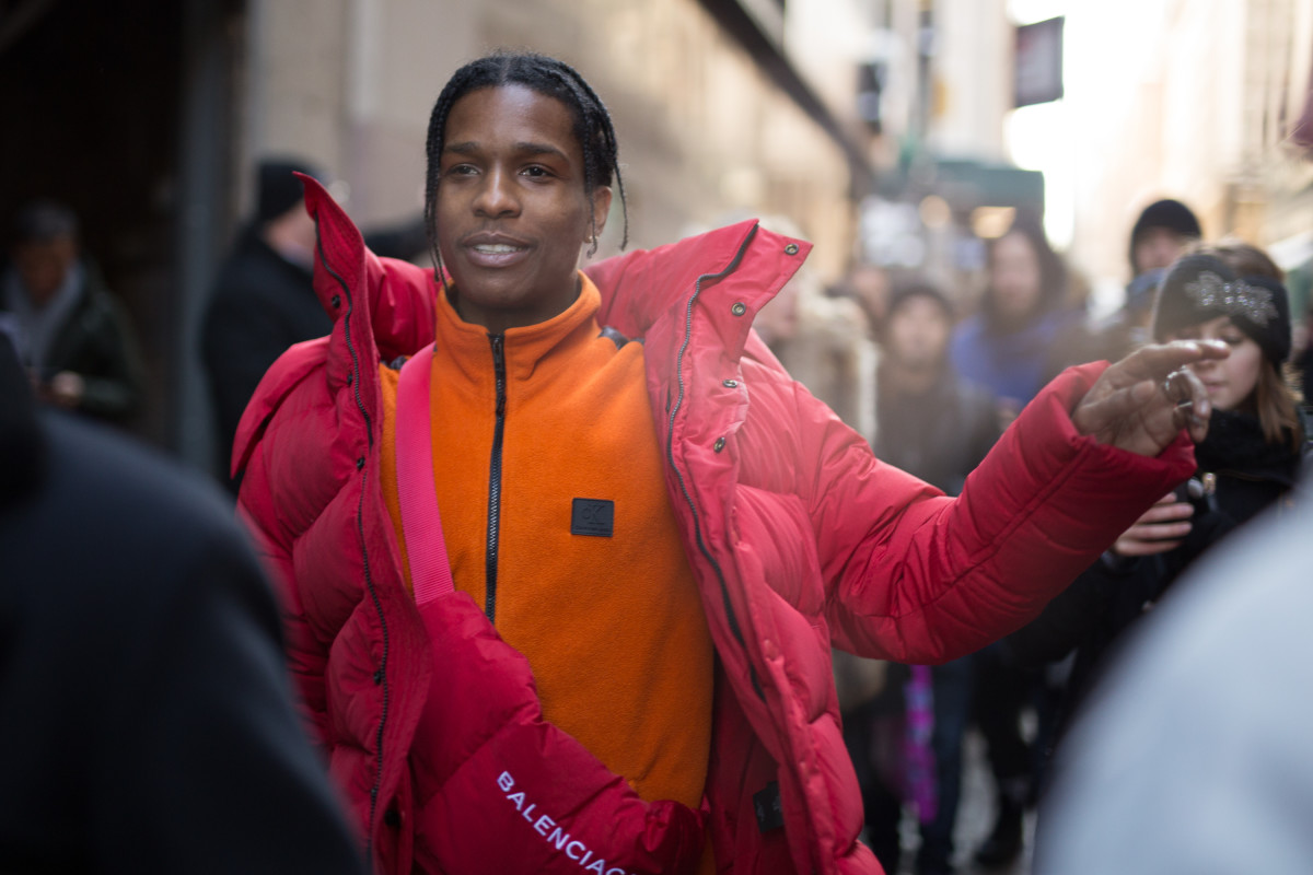 A$AP Rocky wearing an orange Calvin Klein fleece at Calvin Klein's Fall 2017 show during New York Fashion Week.