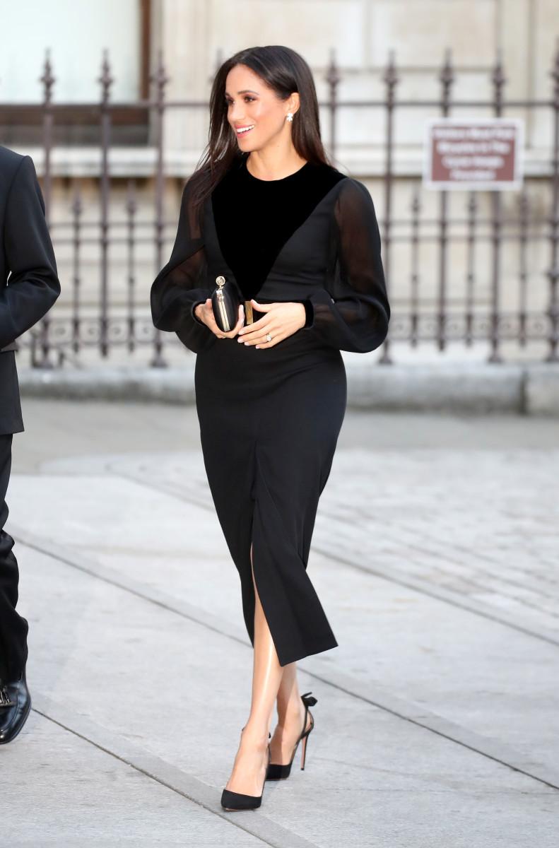 "The Duchess of Sussex in Givenchy at the Royal Academy of Arts opening of the ""Oceania"" exhibit. Photo: Chris Jackson/Getty Images"