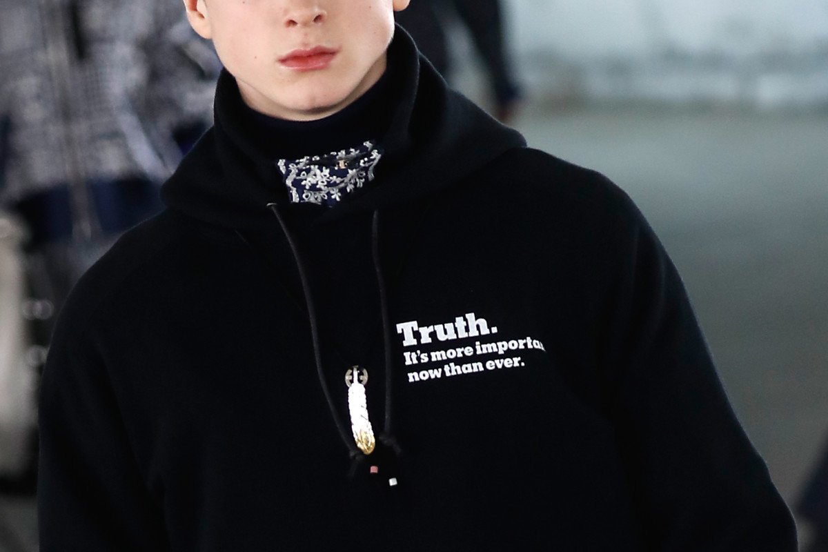 "A ""The New York Times""-branded sweatshirt on the runway during Sacai's Fall 2018 runway show during Paris Fashion Week Men's in January 2018. Photo: Francois Guillot/AFP/Getty Images"