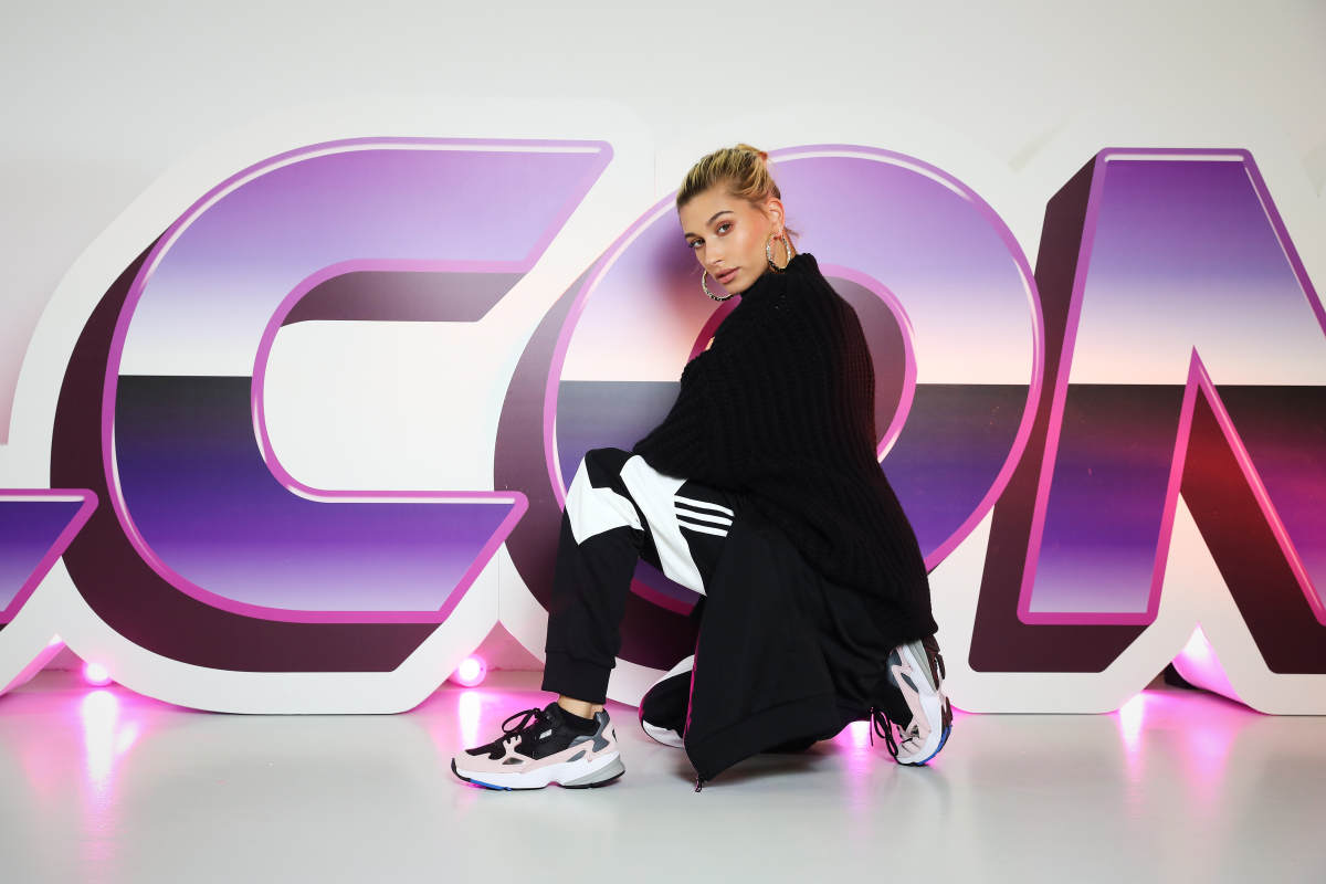 Hailey Baldwin in a pair of Adidas Falcon sneakers at the Adidas x JD show in London. Photo: Tristan Fewings/Getty Images