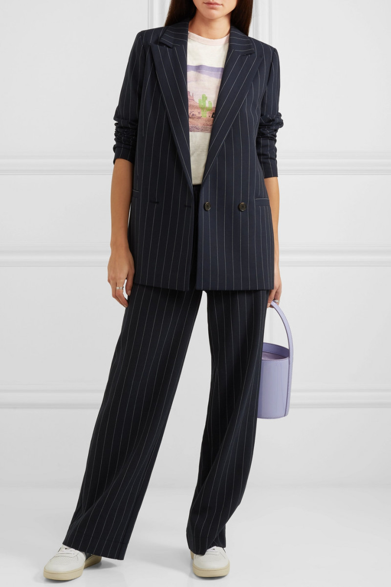 Ganni Hewitt Pinstriped Cady Blazer, $360, available here, and Hewitt Pinstriped Cady Straight-Leg Pants, $250, available here.