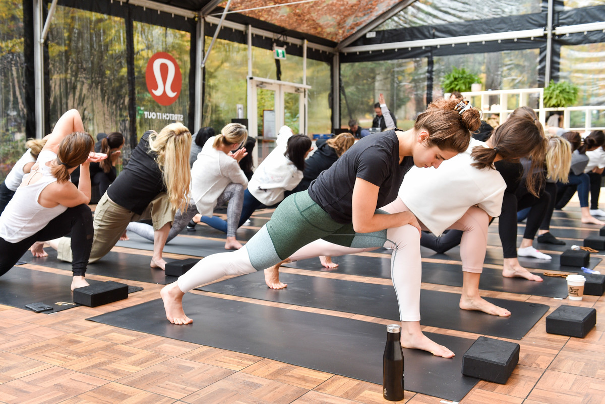 Yoga class at the Lululemon Yoga tent at In Goop Health Vancouver. Photo: Ernesto Distefano/Getty Images