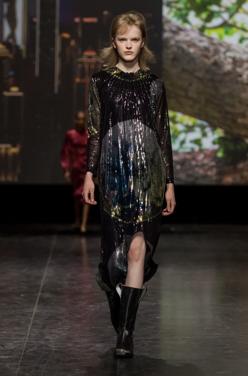 The opening look in Ganni's Fall 2019 collection, featuring a sequined rendering of the globe. Photo: Courtesy of Ganni
