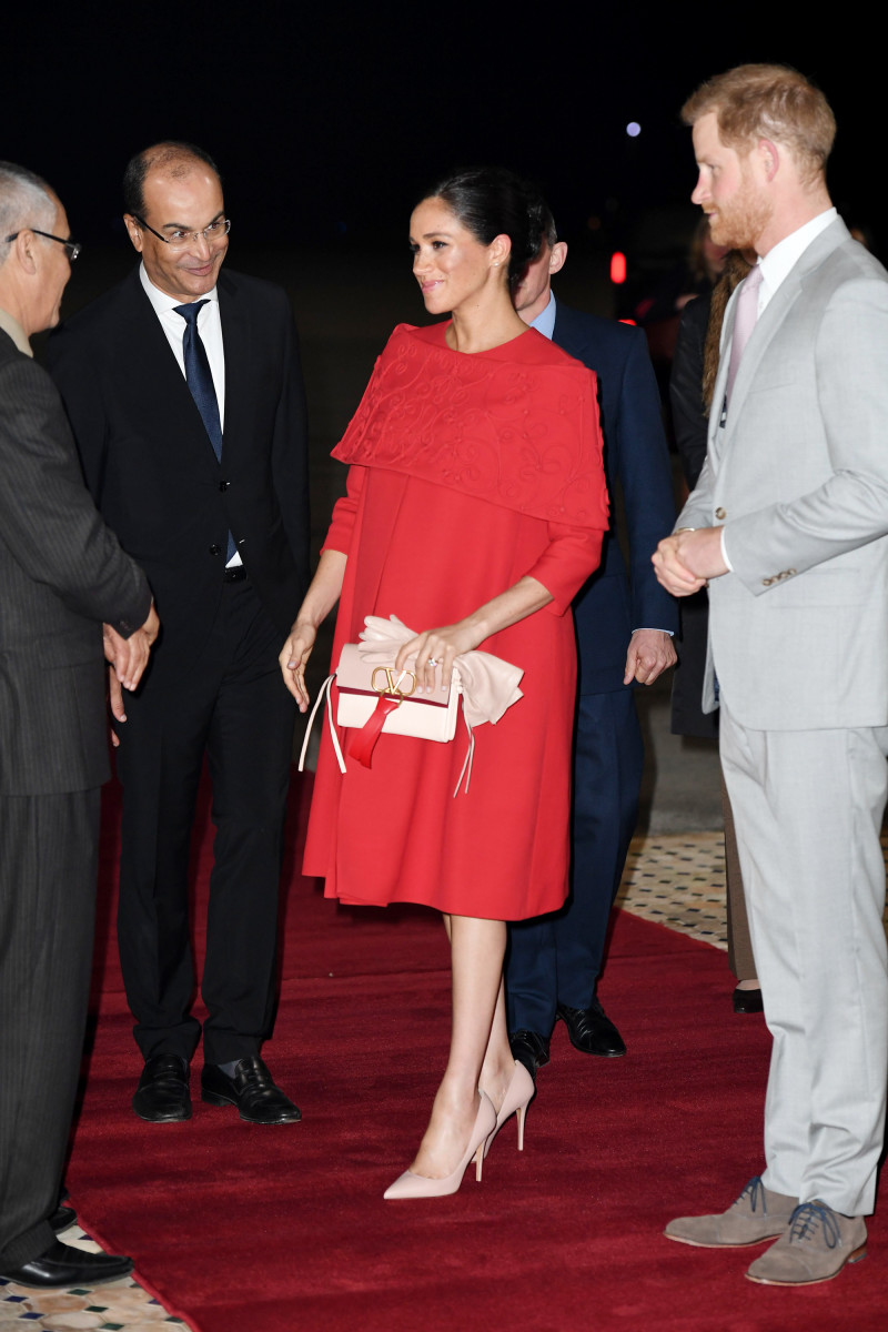 Meghan Markle (in custom Valentino) and Prince Harry arrive at Casablanca airport in Morocco. Photo: Pool/Samir Hussein/WireImage