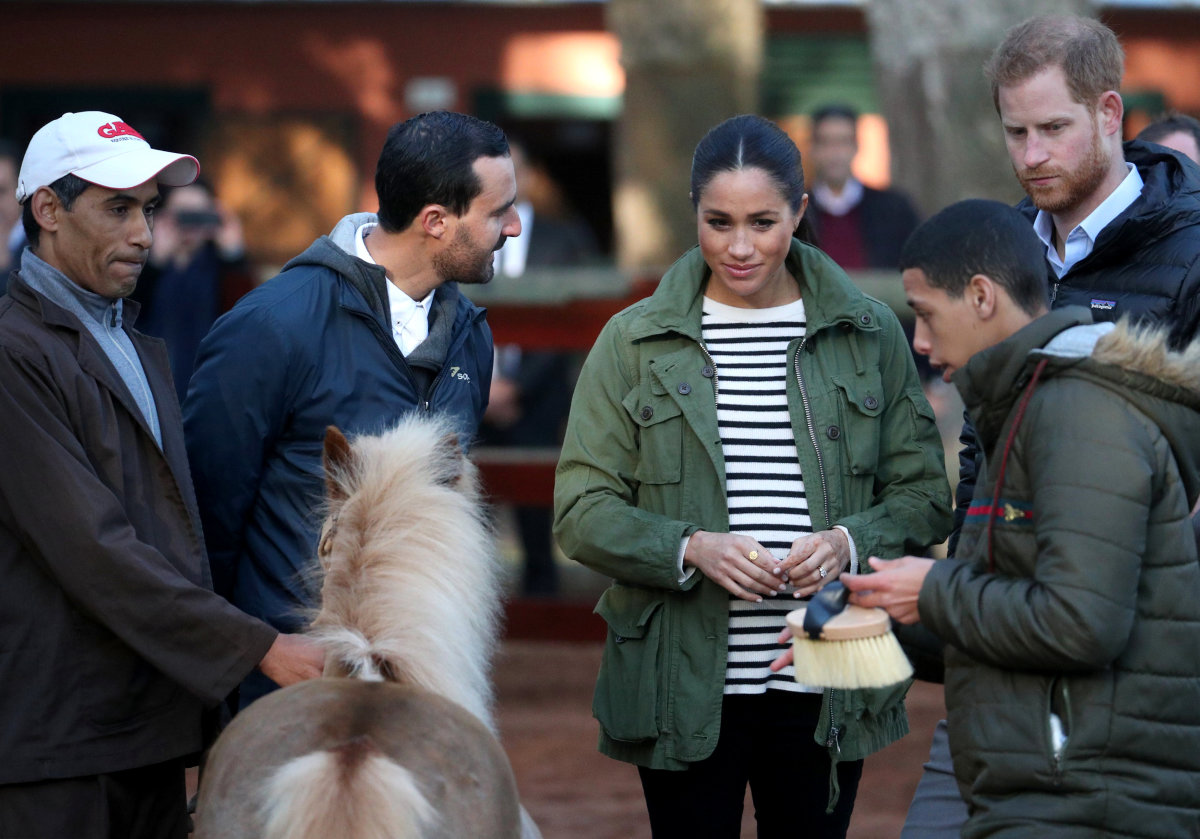 Meghan Markle in a J.Crew jacket at the Moroccan Royal Federation of Equitation Sports in Rabat, Morocco. Photo: Hannah Mckay - Pool / Getty Images