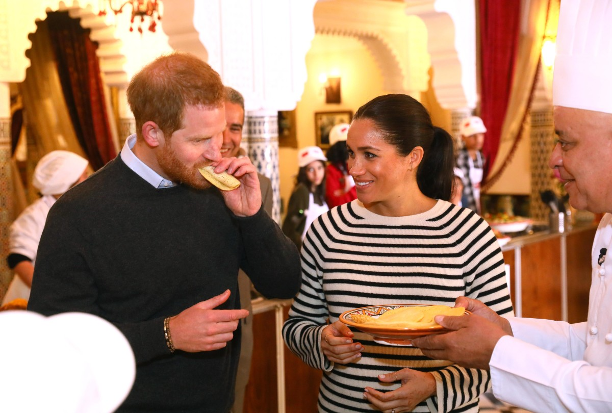 Prince Harry and Meghan Markle in Equipment try some food as they visit a cooking demonstration, where children from under-privileged backgrounds learn traditional Moroccan recipes. Photo: Tim P. Whitby - Pool/Getty Images