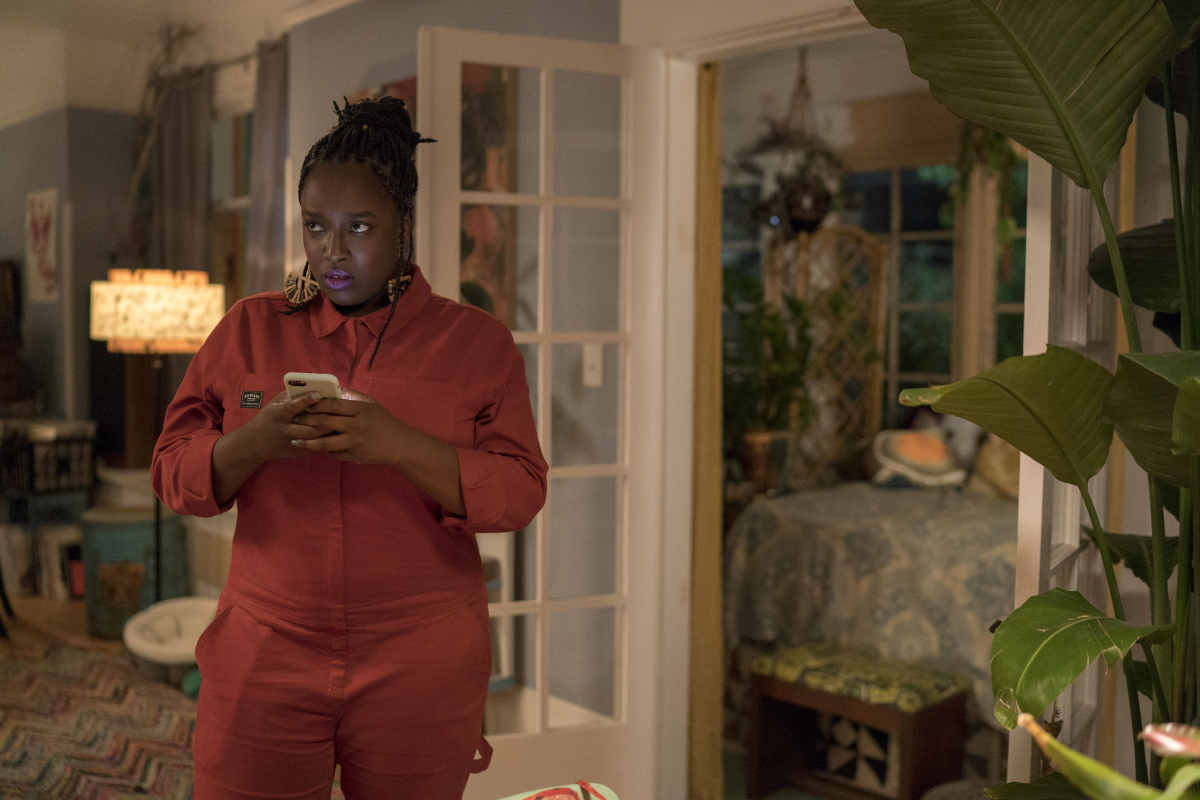 Fran (Lolly Adefope) in the Wildfang jumpsuit. Photo: Allyson Riggs/Hulu