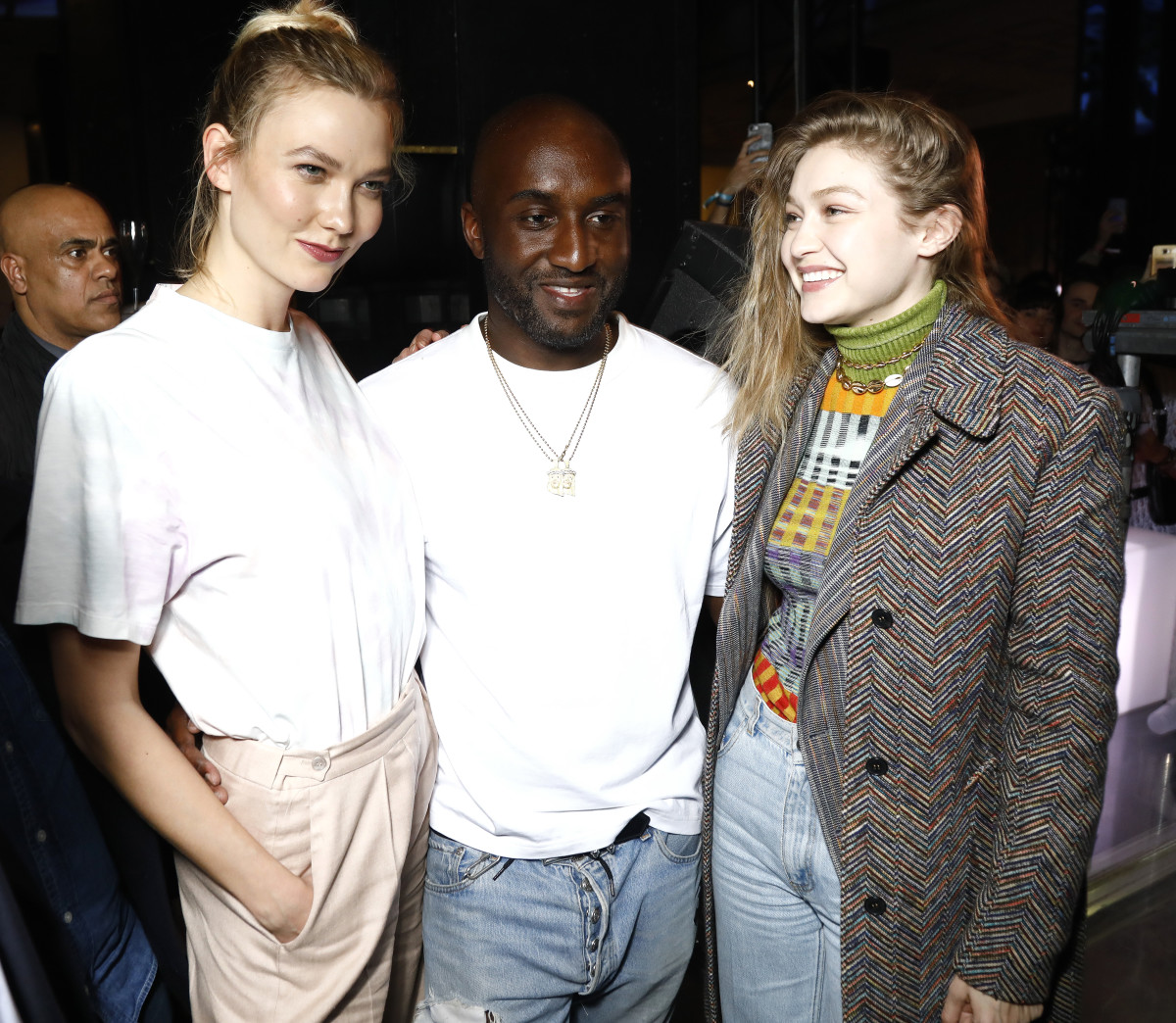 "Karlie Kloss, Virgil Abloh and Gigi Hadid at the launch of Evian and Virgil Abloh's limited-edition ""One Drop can make a Rainbow"" during Paris Fashion Week. Photo: Julien M. Hekimian/Getty Images for EVIAN"
