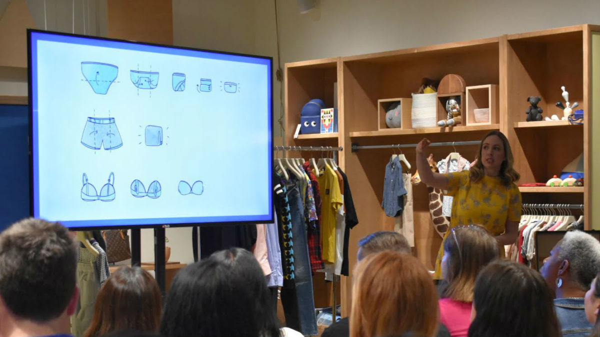 Caitlin Roberts explaining KonMari folding techniques at The RealReal. Photo: Courtesy of The RealReal