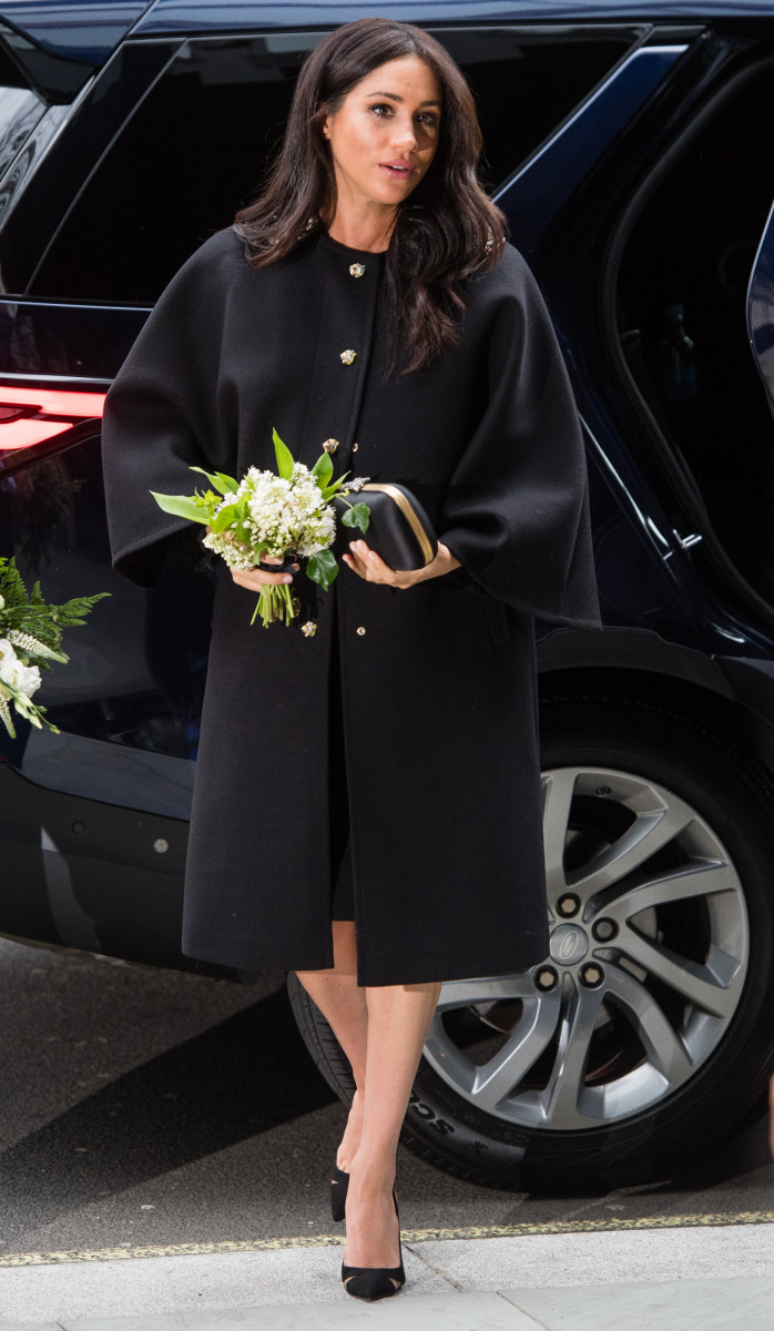Meghan Markle, the Duchess of Sussex, in a vintage black coat during a visit to New Zealand House in London. Photo: Samir Hussein/Samir Hussein/WireImage