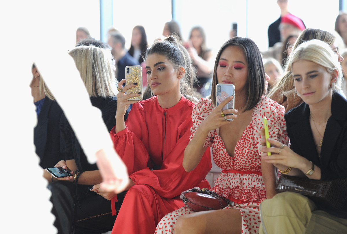 Camila Coelho, Aimee Song and Caroline Daur at Self-Portrait's Spring 2019 show. Photo by Craig Barritt/Getty Images for Self-Portrait