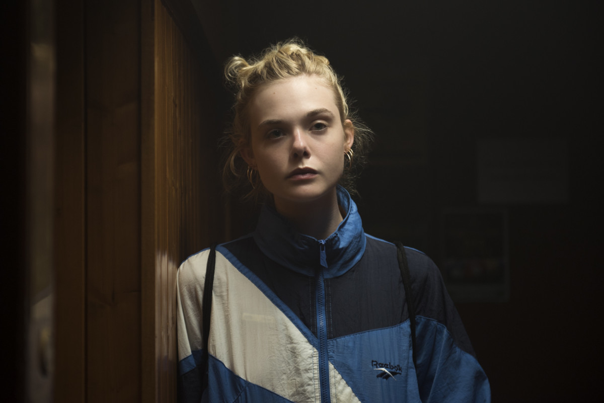 Violet (Elle Fanning) in her Reebok Classic windbreaker. Photo: Photo: Parisa Taghizadeh/Courtesy of Violet Dreams Ltd
