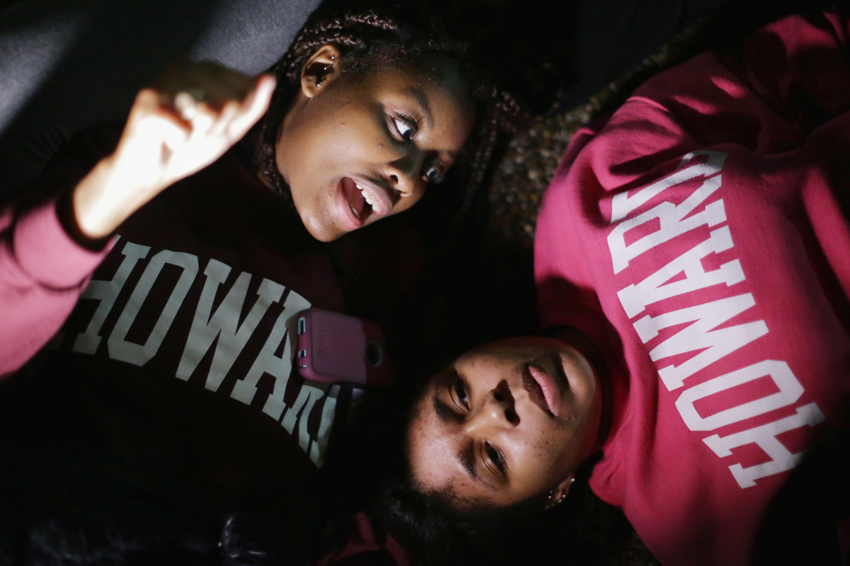Howard University students lay on the ground in protest outside the White House in protest of the shooting death of Michael Brown in Ferguson, Missouri Photo: Chip Somodevilla/Getty Images