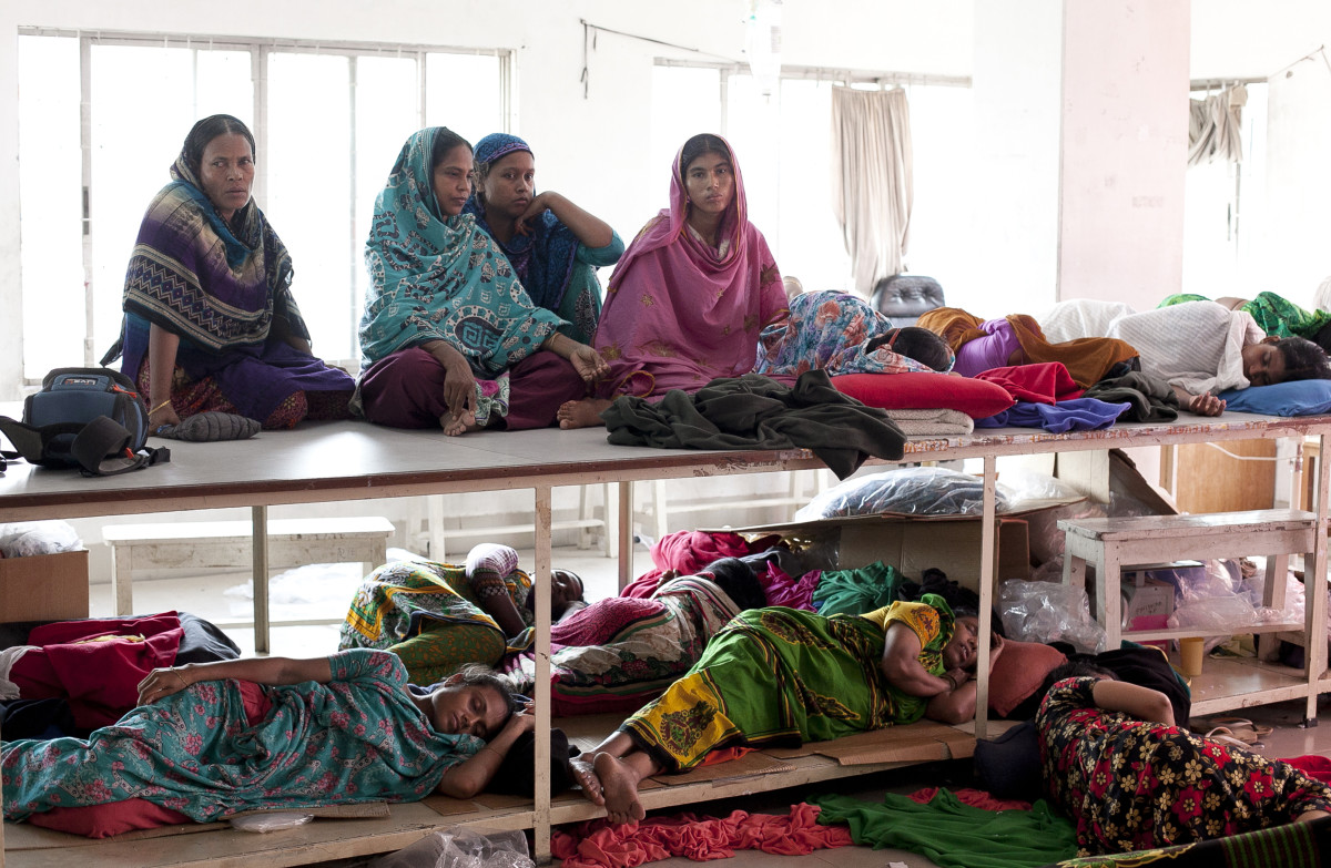 Women rest while participating in a hunger strike in Bangladesh. Photo: Allison Joyce/Getty Images