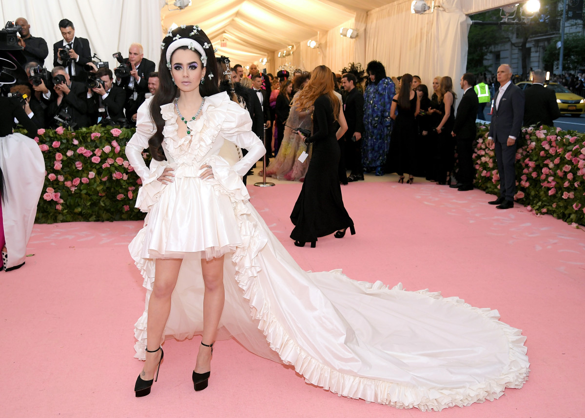 """Lily Collins inGiambattista Valliat the opening of the """"Camp: Notes on Fashion"""" exhibit at the Met. Photo: Dia Dipasupil/Getty Image"""