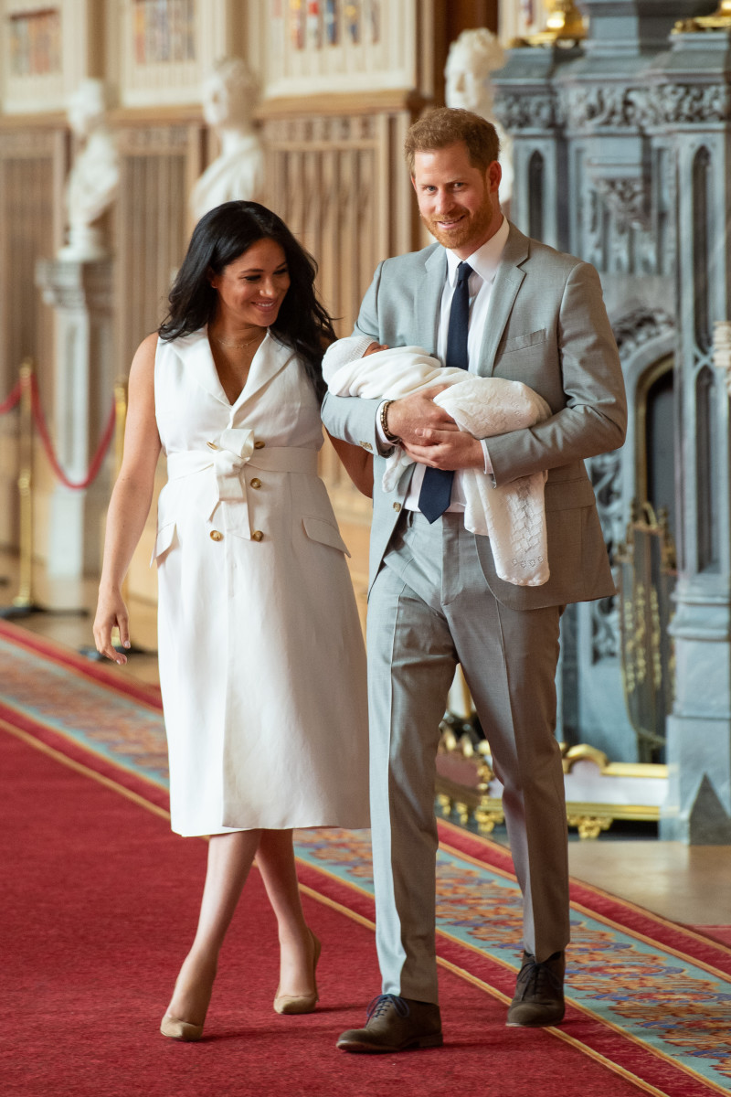 Meghan, Duchess of Sussex, in Givenchy, and Prince Harry, Duke of Sussex, with their newborn son in St George's Hall at Windsor Castle. Photo by Dominic Lipinski - WPA Pool/Getty Images