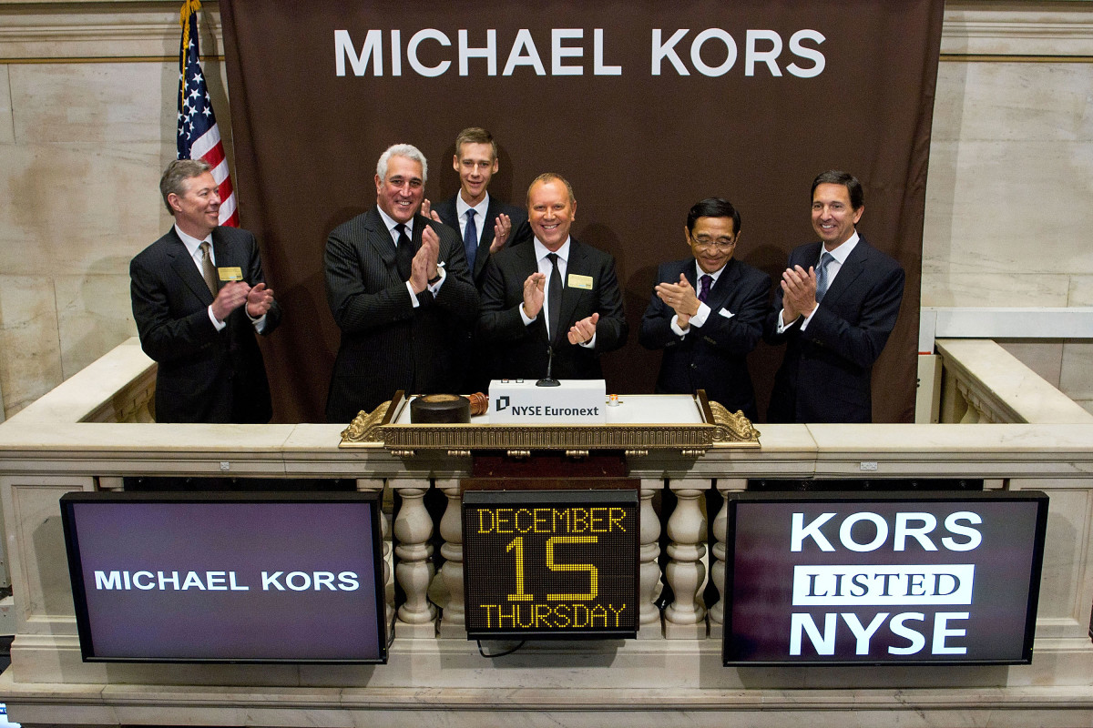 Michael Kors rings the opening bell at the New York Stock Exchange on Dec. 15, 2011