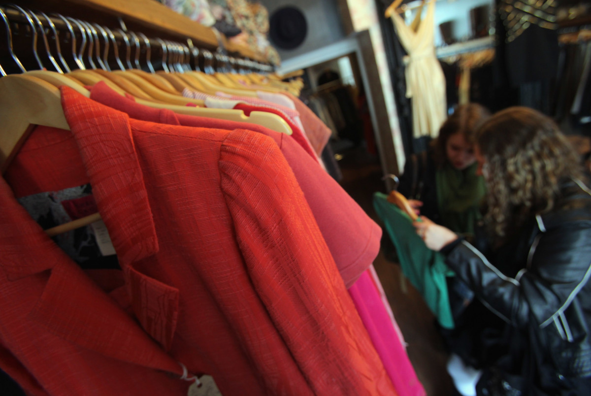 Shoppers browse a vintage clothing store in Ottawa, Canada.