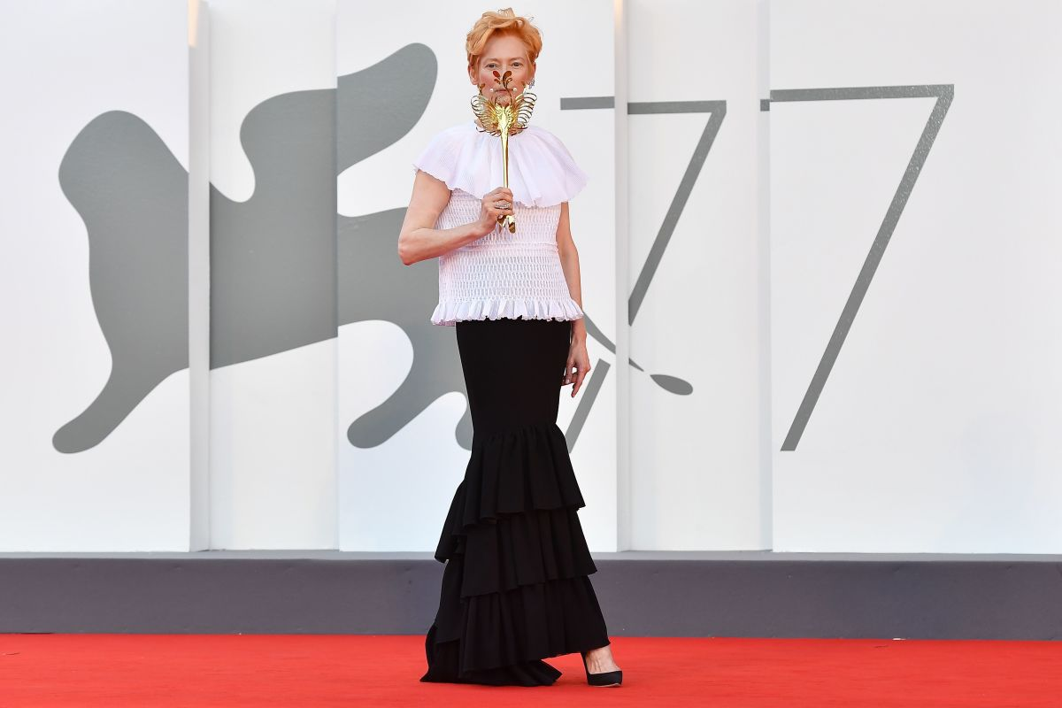 """Tilda Swinton in Chanelat the Opening Ceremony and the """"Lacci"""" red carpet during the 77th Venice Film Festival."""