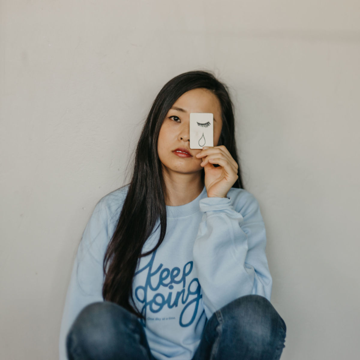 "Self-Care Is for Everyone's ""Keep Going"" sweatshirt, supporting the American Foundation for Suicide Prevention."