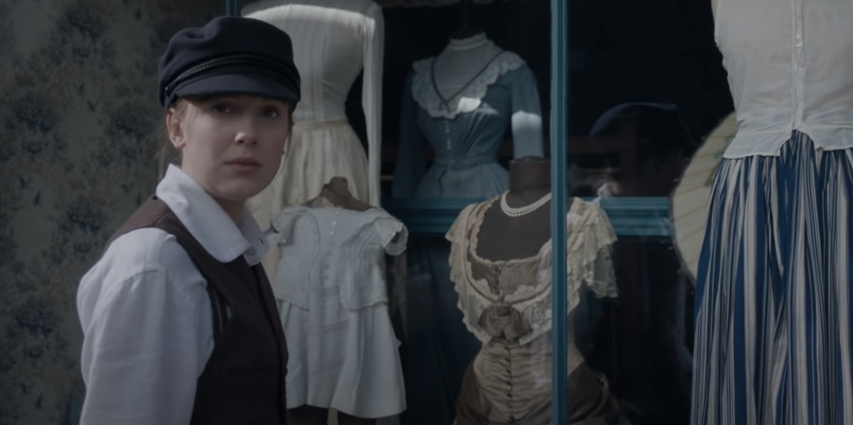 Enola in disguise in young Sherlock's clothes.