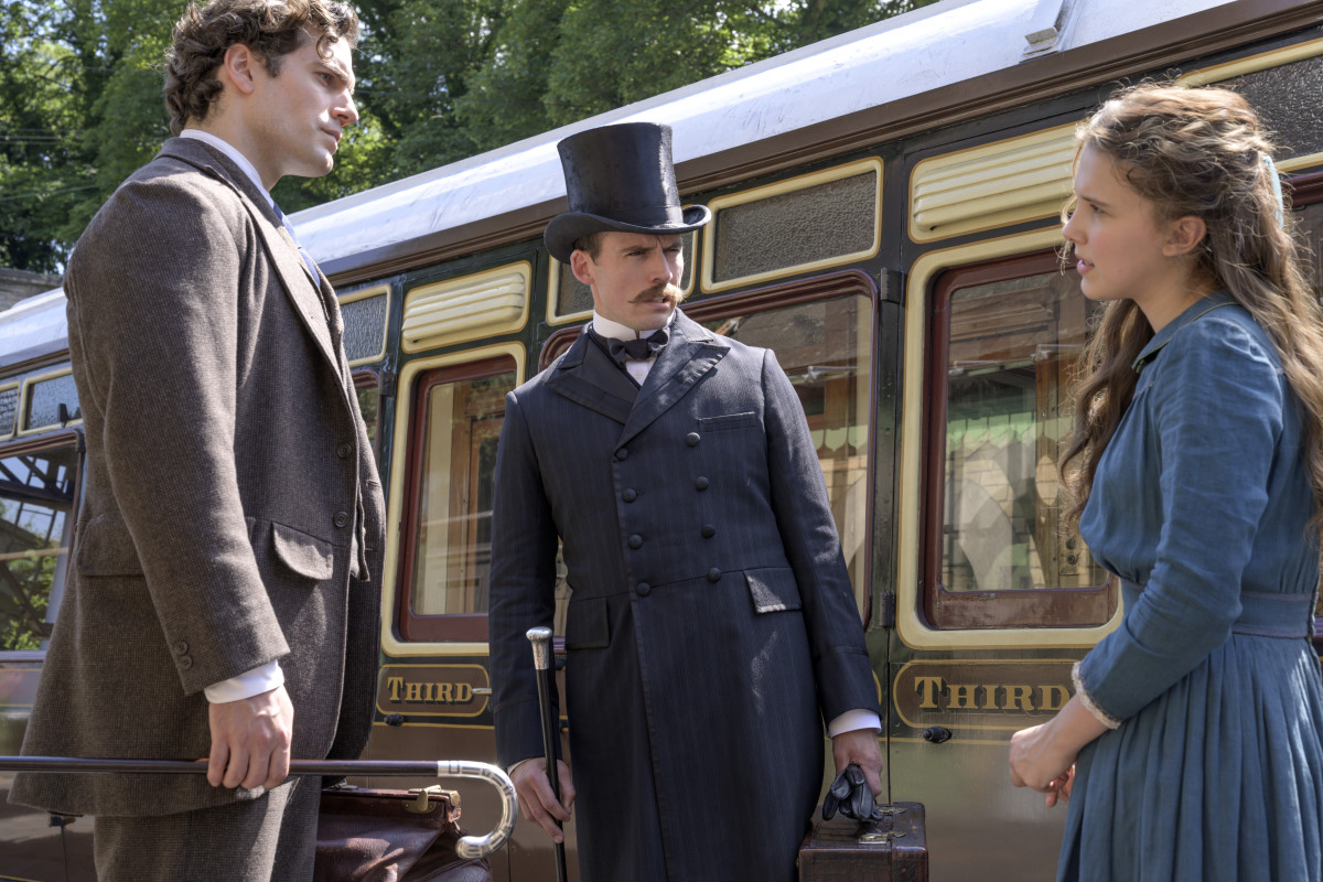 "'He's very at ease in his costume, so that gave an aura of loosening of things, as well as, the strength of the silhouette,' says Boyle, about the ""fresh"" new take on Sherlock, as played by Superman (Cavill, left), with a disapproving Mycroft and a hat and gloveless Enola."