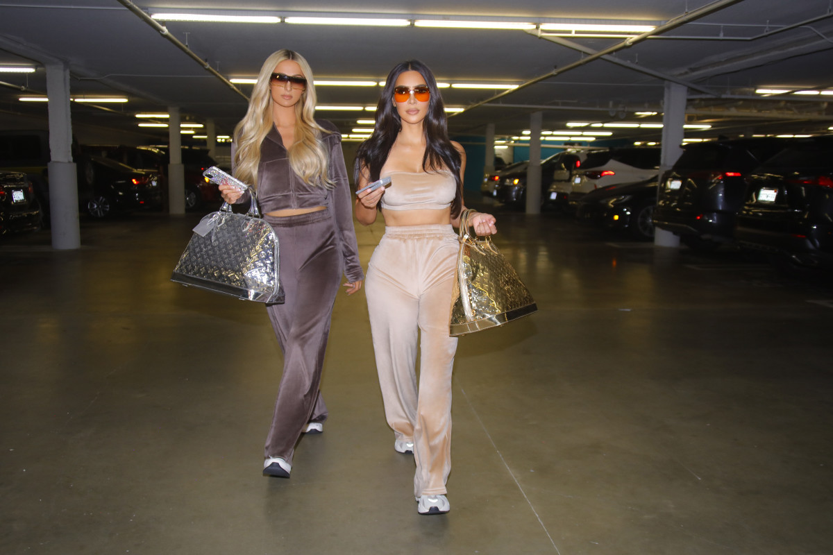 Kim Kardashian West and Paris Hilton in pieces from Skims' Velour collection.