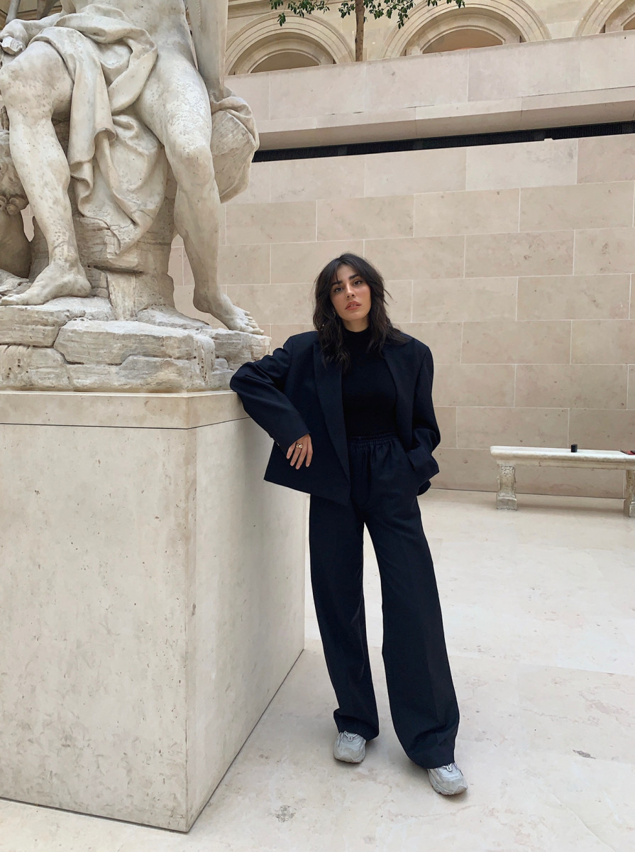 Carloto in an Acne jacket and black turtleneck at the Louvre in Paris.