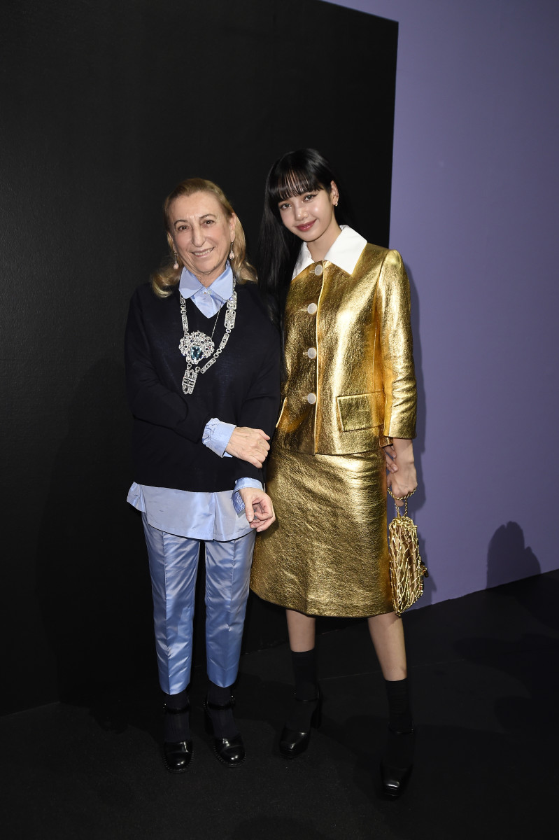 Lisa, a Global Ambassador for Celine (and a muse of Hedi Slimane) poses with Miuccia Prada at Prada's Fall 2020 runway show during Milan Fashion Week.