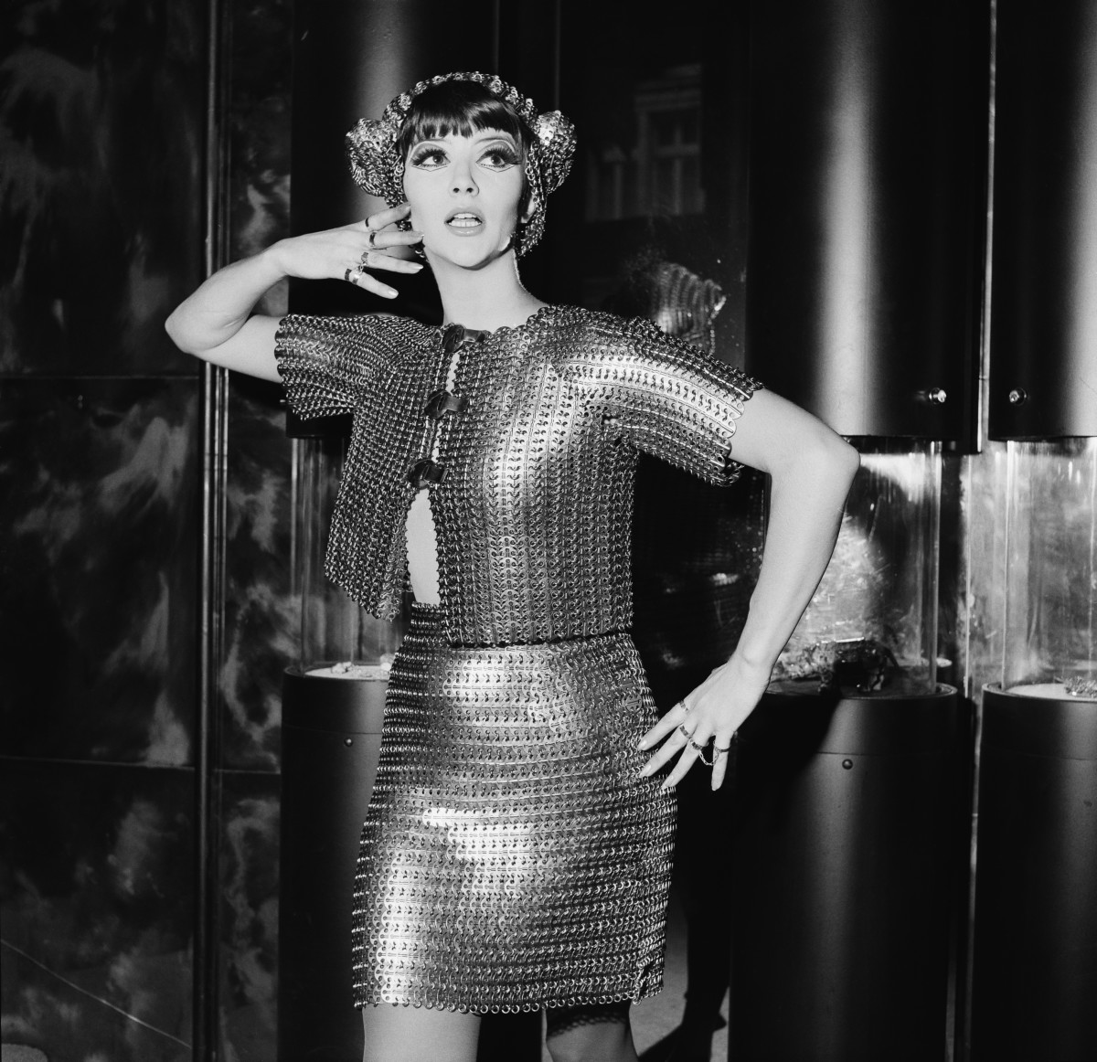 Model Jackie Bowyer wears a silver chainmail bolero with a matching miniskirt by Paco Rabanne in 1967.