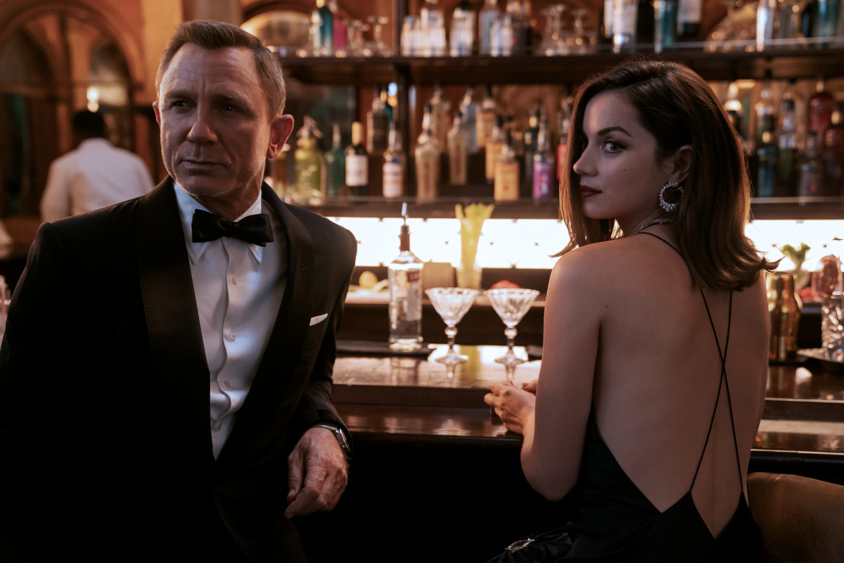 Daniel Craig as James Bond and Ana de Armas as Poloma in 'No Time to Die,' costume design by Suttirat Larlarb.