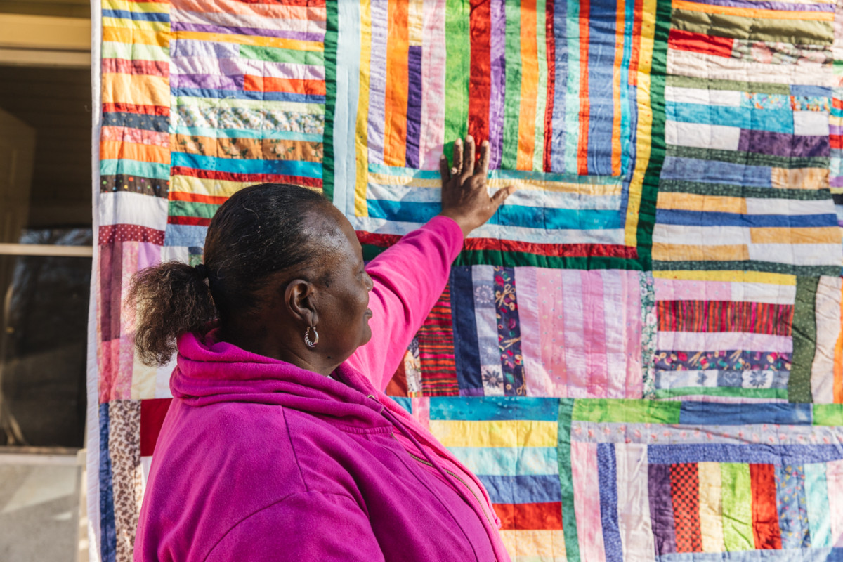Sharon Williams with one of her quilts.