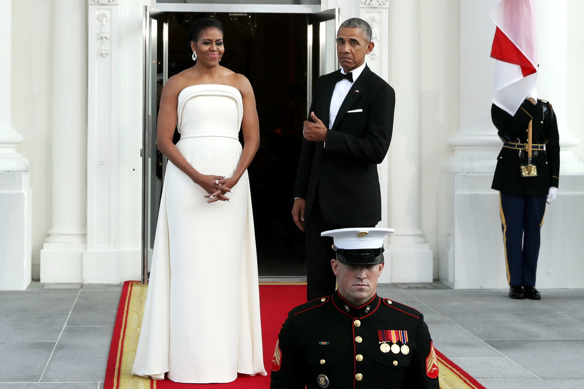 Michelle Obama, wearing Brandon Maxwell, and former president Barack Obama, approving of the look, at a 2016 Singapore State Dinner.