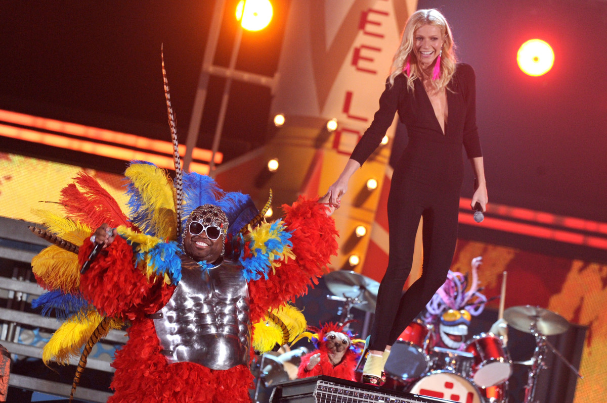 Gwyneth Paltrow, with Cee-Lo Green, performing on stage at the 2011 Grammys, wearing pink earrings by Wilfredo Rosado.