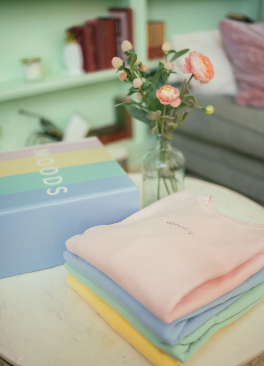 A stack of Moods Clothing's candy-colored sweatshirts.