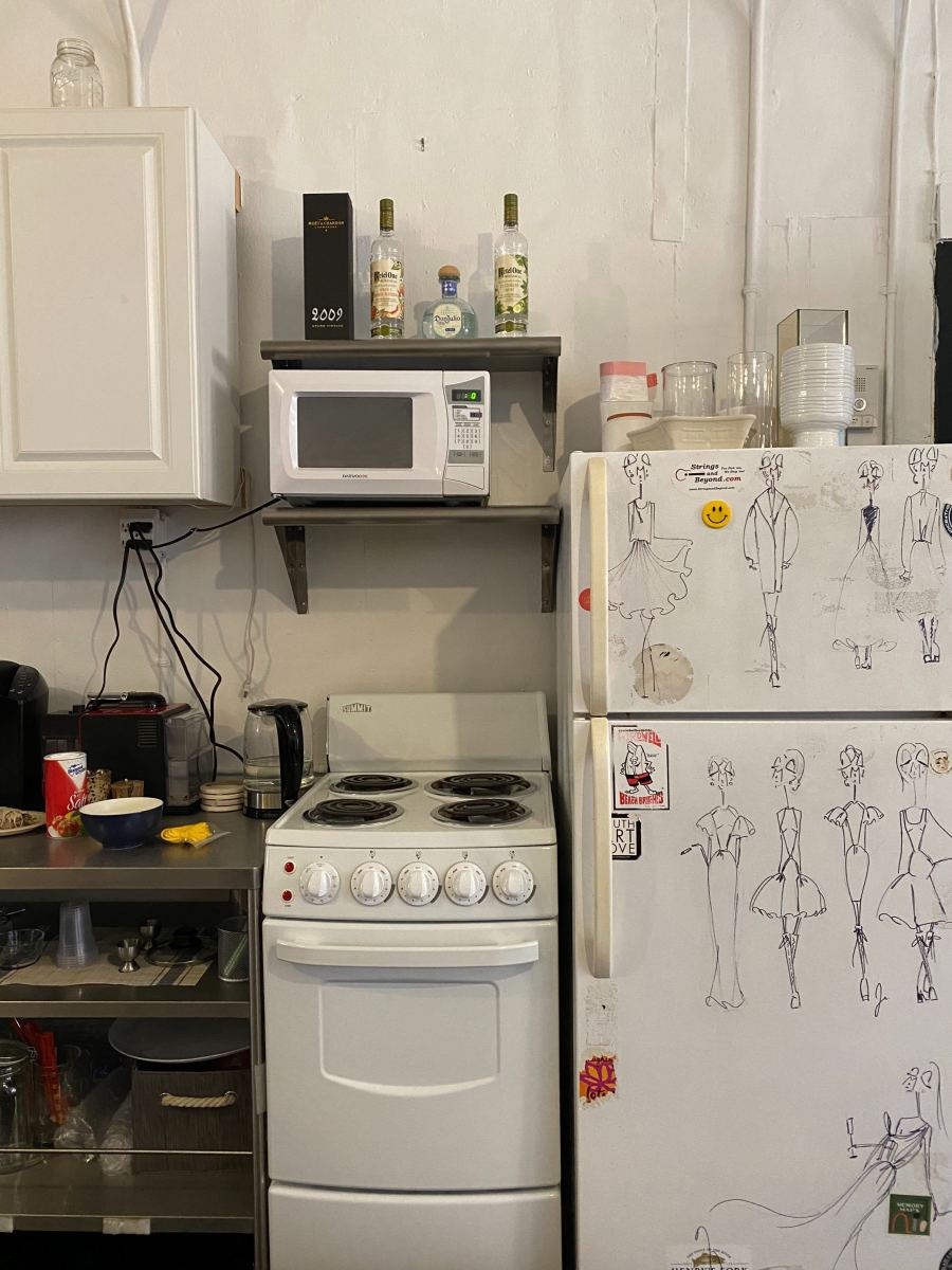 The kitchen in the studio. (Those are Cohen's doodles on the refrigerator door.)