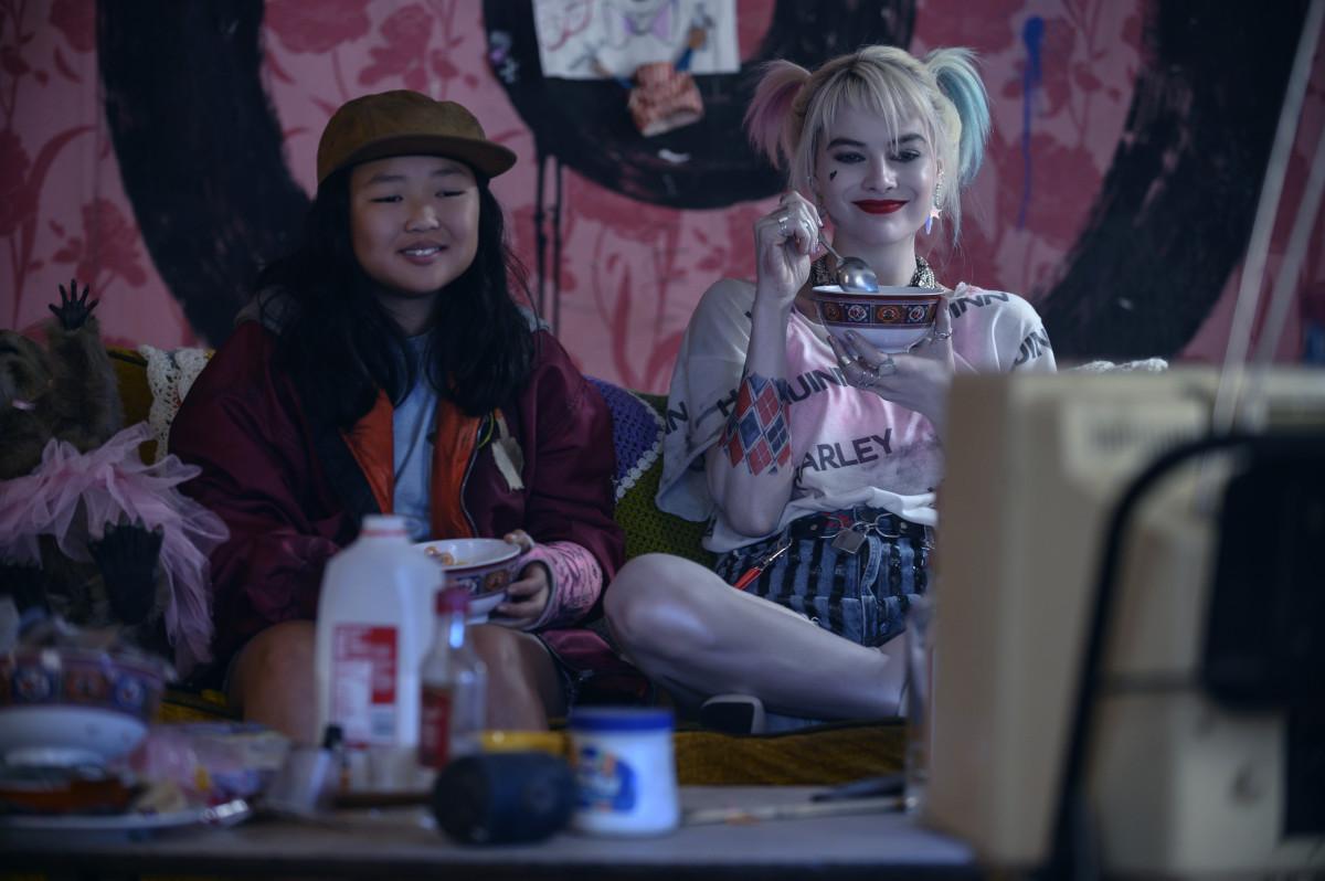 Cassandra and Harley kick back and watch cartoons.