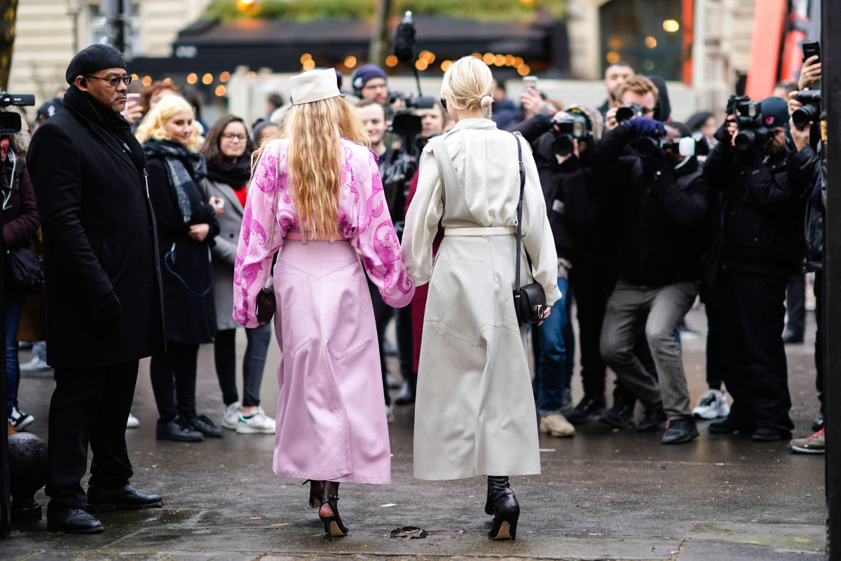 Influencers being photographed outside a Nina Ricci show.