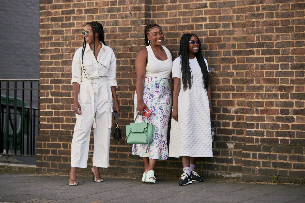 Lindsey Peoples Wagner (center) wearing a Rixo skirt during London Fashion Week in September 2019.
