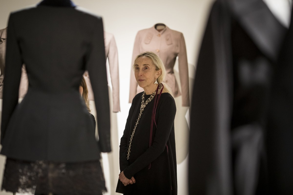 Carla Sozzani admires Alaïa's designs, with Adrian's behind her, at the opening reception of 'Alaïa-Adrian: Masters of Cut' at theSCAD FASH Museum of Fashion + Film in Atlanta.