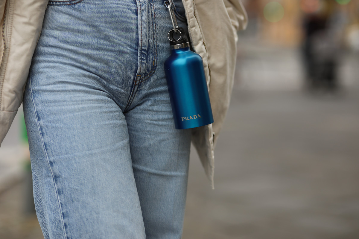 Prada's much-hyped water bottle, pictured here in a Berlin street style shot.