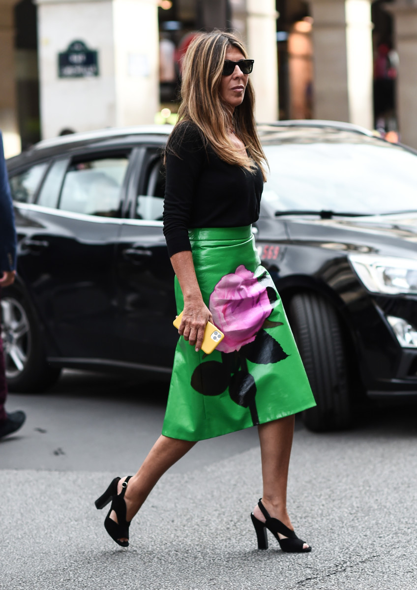 Nina Garcia at Paris Fashion Week in September 2019 in her classic black sweater and Prada investment purchase.
