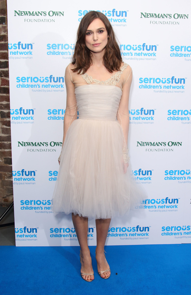 Celebrity News The final public appearance of Keira Knightley's Chanel wedding dress at the SeriousFun London Gala in December 2013.