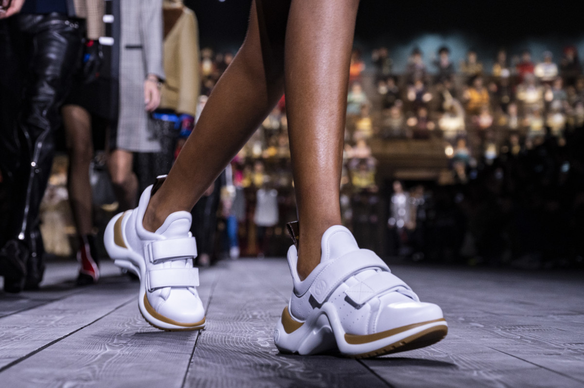 A pair of Louis Vuitton's iconic Archlight sneakers walk the house's Spring 2020 runway at Paris Fashion Week.