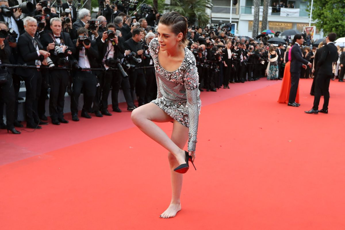 "Kristen Stewart removing her shoes at the ""Blackkklansman"" screening at the Cannes Film Festival in 2018."