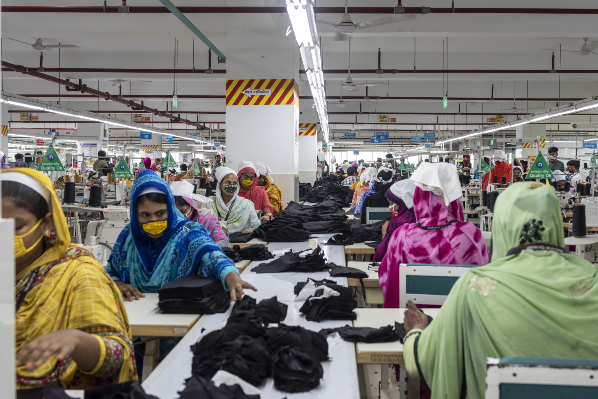 A group of women working in a denim factory in Bangladesh.