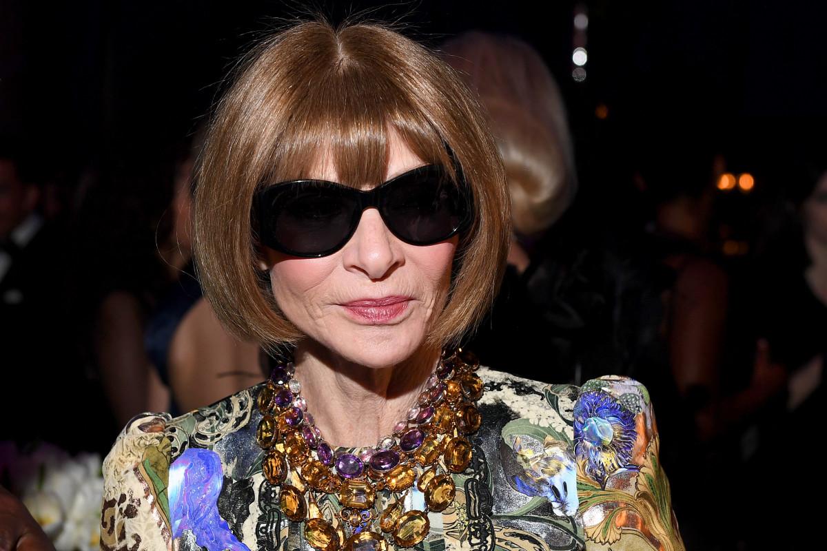 This is the Anna Wintour we're used to, complete with dark glasses, bejeweled necklaces and floral dress.