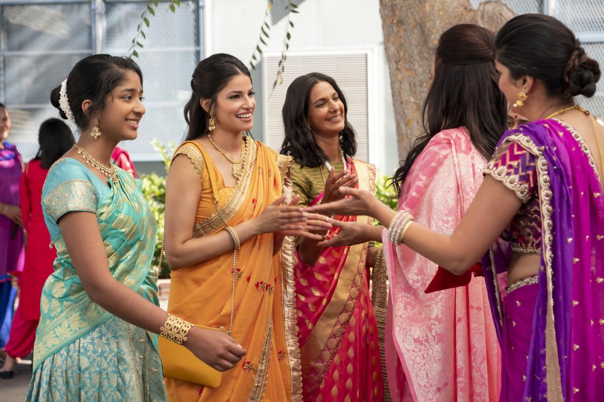 Devi, Kamala (Richa Moorjani) and Nalini (Poorna Jagannathan) greet the aunties at Ganesh Puja.