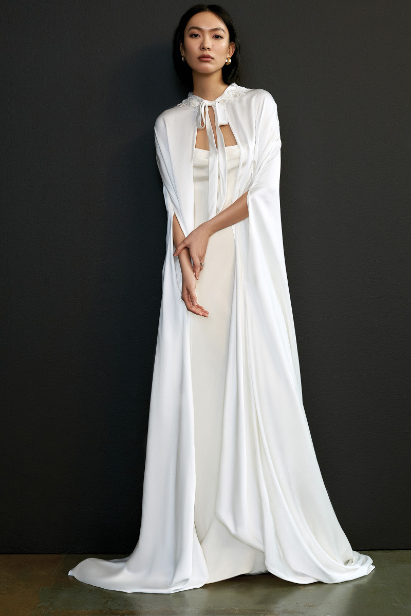 A cape and wedding dress from the Savannah Miller Spring 2021 collection.