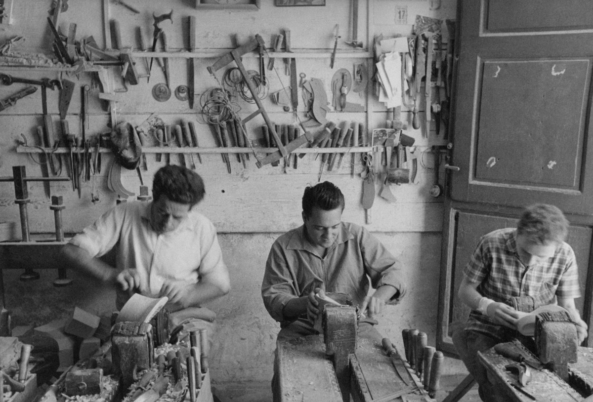 Craftsmen at work in a Florence shoe factory in 1955.